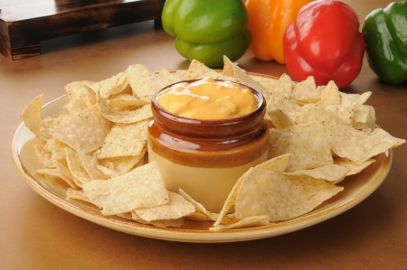 A party tray of tortilla chips with salsa con queso