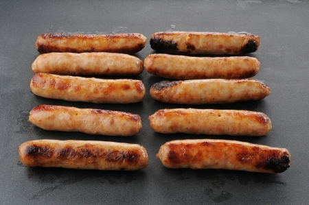 nonstick: Maple flavored link sausages cooking on a non-stick grill