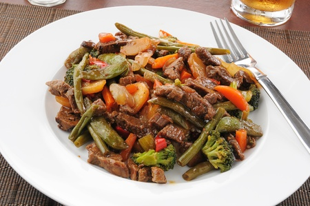 Beef stir fry with beans, broccoli, sugar snap or snow peas and carrots