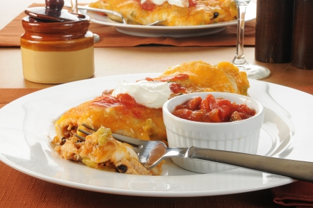 smothered: A large smothered burrito topped with cheese and salsa