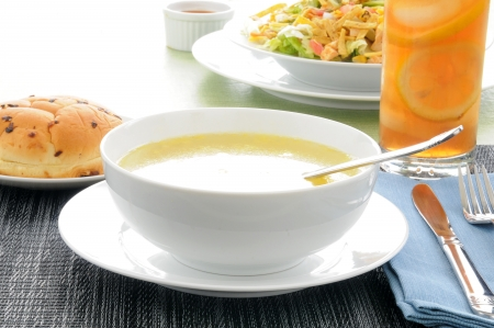 A bowl of chicken noodle soup with a taco salad