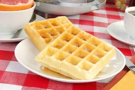 checker plate: Close up of waffles with syrup and pink grapefruit Stock Photo
