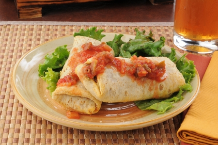 burrito: A plate of beef and bean chimichangas with salsa