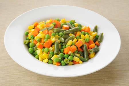 A serving bowl of mixed vegetables