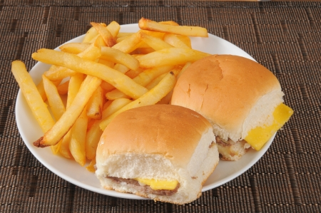 Two mini cheeseburgers and french fries photo