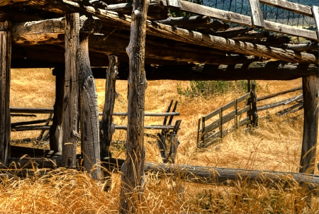 An open corral gate on a southwestern ranch, this is an HDR image Фото со стока