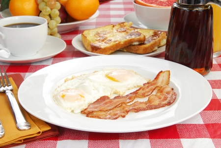 Bacon and eggs with french toast and grapefruit photo