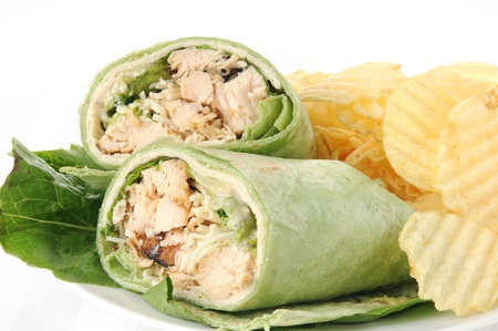 Closeup of a chicken ceasar wrap sandwich with chips photo