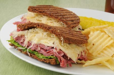reuben: Closeup of a reuben sandwich with potato chips