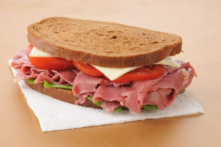 A corned beef sandwich on rye on a paper napkin photo