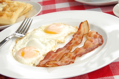 Close up of bacon and eggs with a waffle Archivio Fotografico