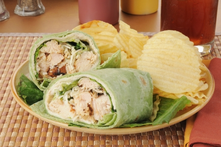 A chicken Caesar wrap with parmesan cheese wrapped in a spinach tortilla photo