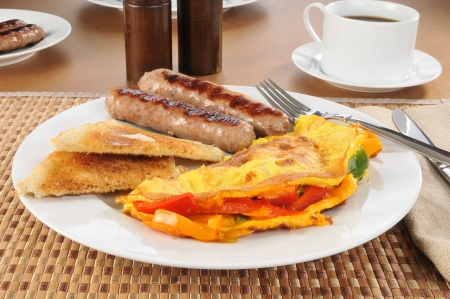 A western omlet with sausage and toast