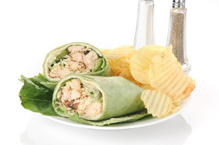 A chicken ceasar sandwich wrap with parmesan cheese photo
