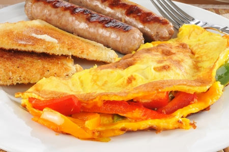 Closeup of a western omlet with sausage and toast