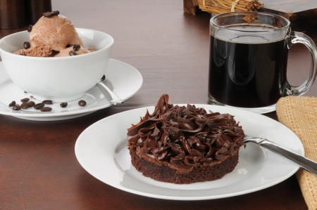 A brownie with a bowl of coffee flavored ice cream photo