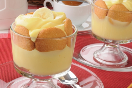 Dessert cups of pudding with vanilla wafers and bnana slices