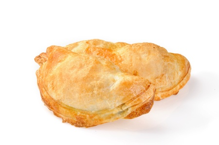 Golden empanada pastrys on a white background