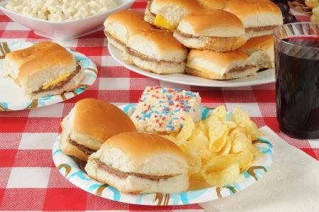 sliders: Mini cheeseburgers on a picnic table