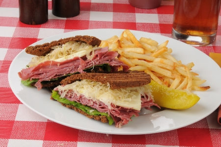 reuben: A Reuben sandwich on dark rye with french fries Stock Photo