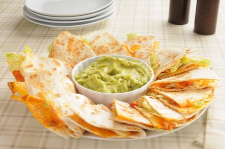 Cheese quesadillas with guacamole photo