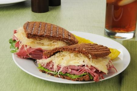 reuben: A reuben sandwich with a dill pickel