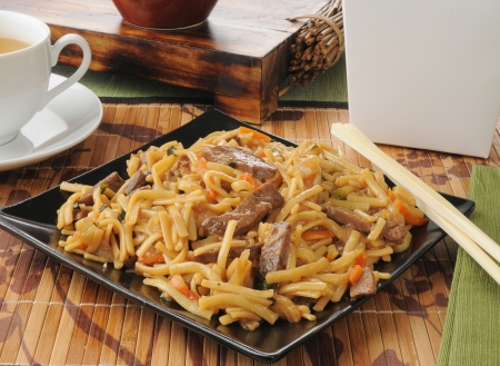 Beef lo mein with chopsticks photo
