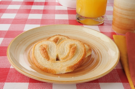 A plate of petite palmiers or buttery flakey pastries