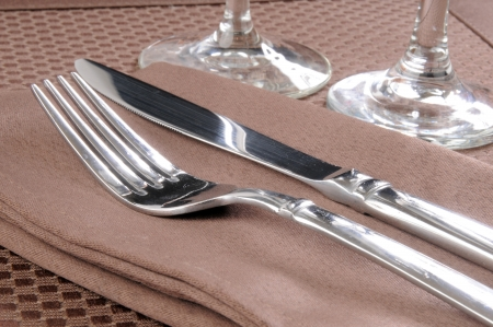 stemware: A knife and fork on an elegant table setting