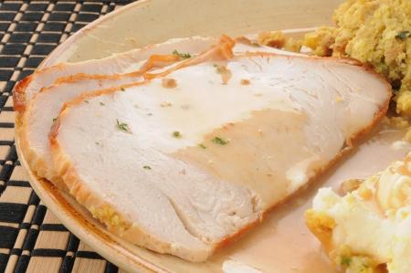 Close up of sliced turkey smothered in gravy Standard-Bild