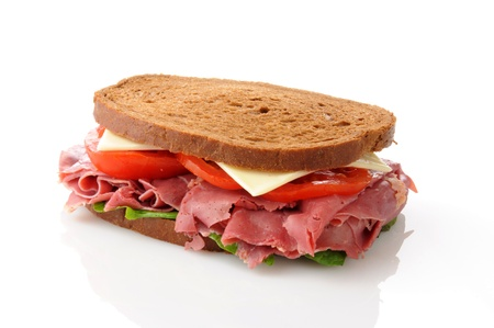 A corned beef sandwich on a white background