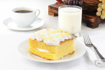 A slice of lemon cake with coffe Stock Photo - 15195333