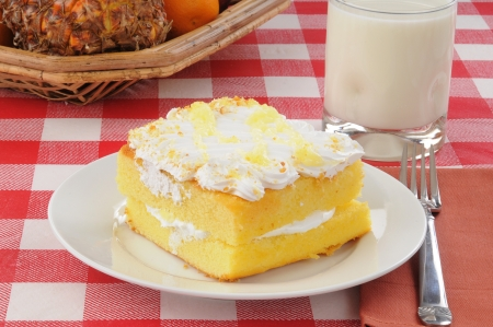 A slice of lemon cake with milk Stock Photo