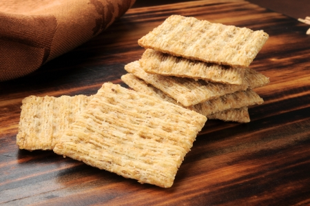 Closeup of whole wheat crackers on a chopping block photo