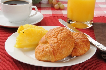 buttery: Buttery croissants with pineapple, orange juice and black coffee