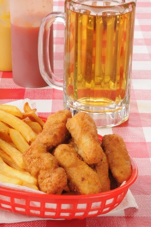 Honey battered chicken strips and a mug of beer photo