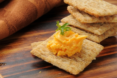 Whole wheat crackers with smoked cheddar cheese spread and parsley