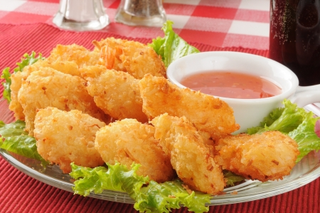 Close up of coconut shrimp with a soft drink photo