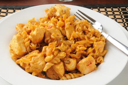 Bowl of chicken casserole with noodles in a cheesy barbecue sauce Stock Photo