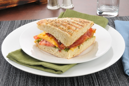 A grilled BLT panini on focaccia bread photo