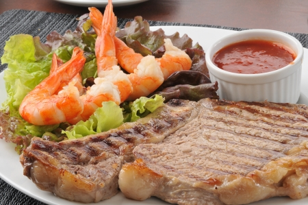 Closeup of a rib steak with shrimp and cocktail sauce Stock Photo - 15094803