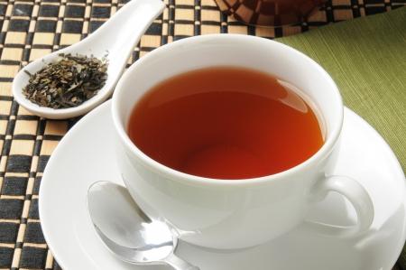 Organic whole leaf tea in a teacup Фото со стока