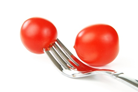 Two cherry tomatoes on a white background
