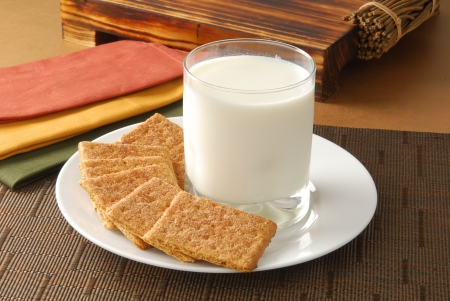 graham: A plate of graham crackers with a glass of milk Stock Photo