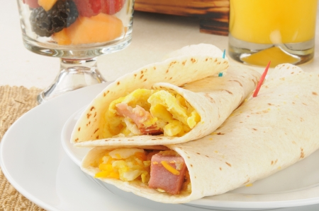 burrito: Ham and egg burrito with fruit cocktail for breakfast