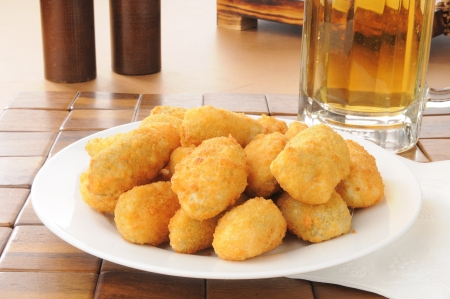 poppers: A plate of poppers with a mug of beer