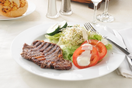 A grilled steak with a healthy salad Stock Photo - 15229462