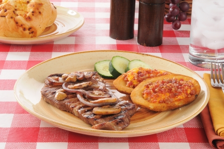 skins: Grilled steak with potato skins stuffed with cheddar cheese and bacon