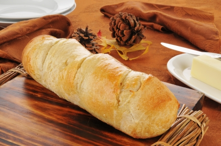 flaky: A loaf of fresh baked Italian bread cooling on a cutting board