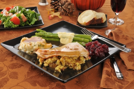 A turkey dinner on a holiday table setting